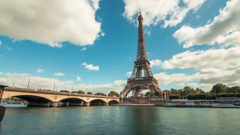 A timelapse of the Eiffel Tower along the river Seine with flyboats (bateaux mouches) passing by with motion blur. 20 minutes Timelapse, 4K.