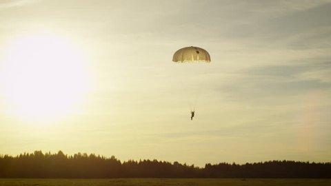 Shot of Landing Skydivers in Sunset Light. Shot on RED Cinema Camera in 4K (UHD).