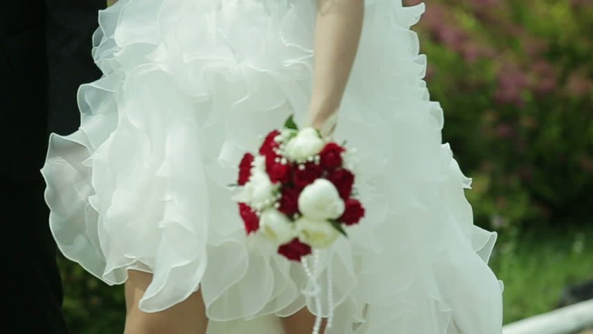 Bridal bouquet n the hands of the bride | Shutterstock HD Video #11593277