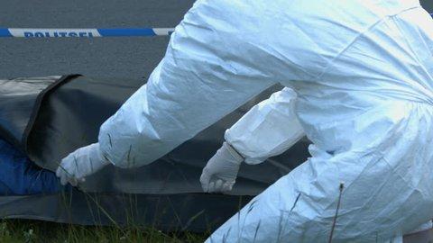 coroner zip the body bag corpse inside
