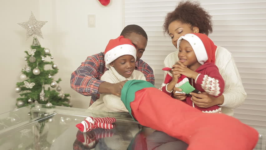 black family opening christmas gift - Black Family Christmas Pictures