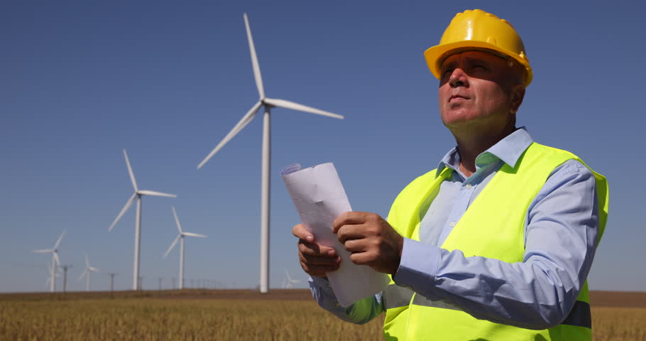 Wind turbine field power farm engineer talking man discuss people engineer manager check blueprint technical drawing wind turbine farm paper plans ultra high definition malvernweather Gallery