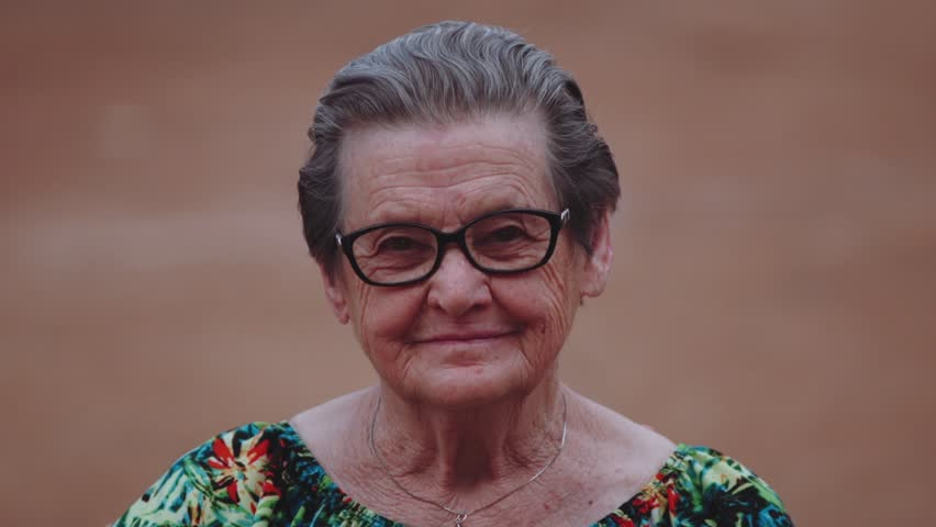Smiling elderly woman looking at camera