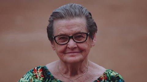 Smiling elderly woman looking at camera