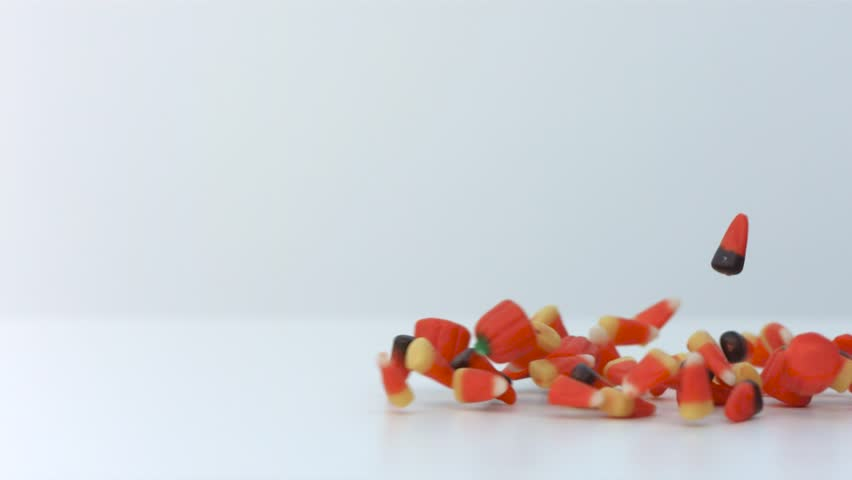 halloween candy mix on a white table hd stock video clip