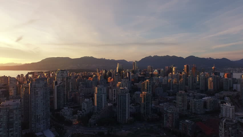 4K aerial vertical pan shot of Vancouver Skyline at sunset. | Shutterstock HD Video #11672279