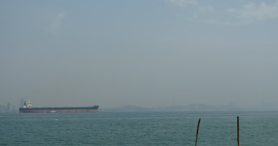 4k Huge container oil tanker ship on ocean,modern building background. gh2_10959_4k