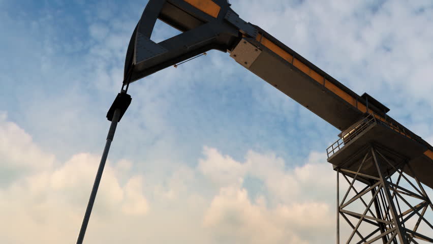 Working oil pumps. View sideways pan.