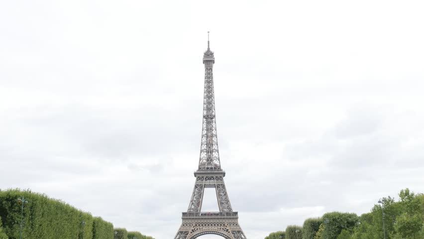 Champ de Mars Tour Eiffel lattice costruction in Paris France tilting 4K 2160p UltraHD footage - Slow tilt on Eiffel tower French famous landmark 4K 3840X2160 30fps UHD video | Shutterstock HD Video #11783159