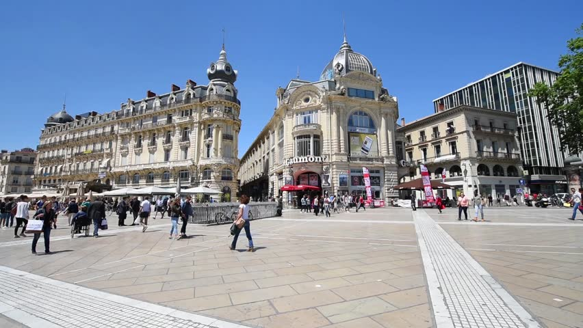 MONTPELLIER, FRANCE - MAY 22, 2015: People are walking on the Place de la Comédie square, main focal point of the city of Montpellier