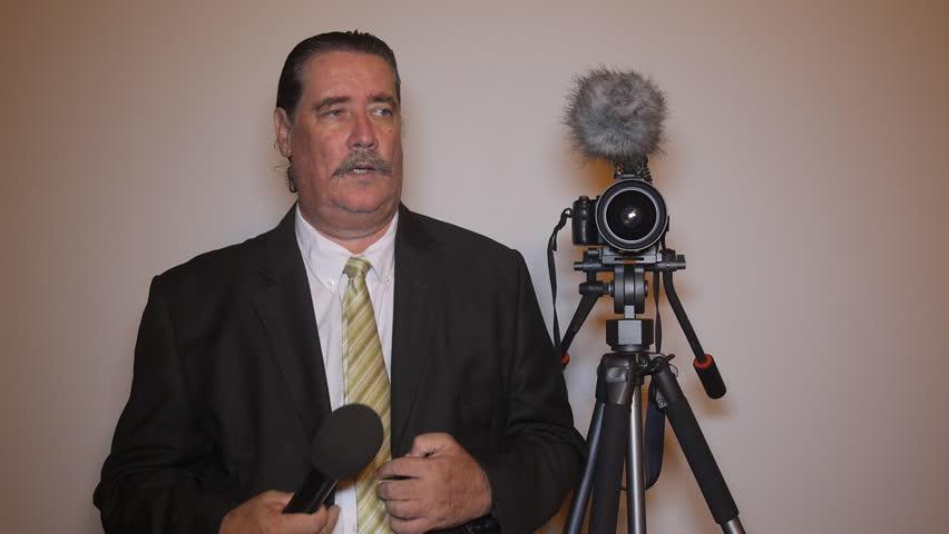 Man acting as a TV reporter  | Shutterstock HD Video #11805332
