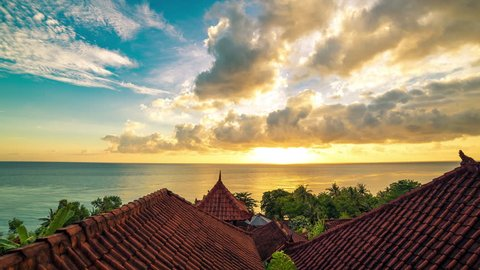 4K Timelapse. Sunrise overlooking the roofs of the bungalows and the Indian Ocean. 15 July 2015, Bali, Indonesia