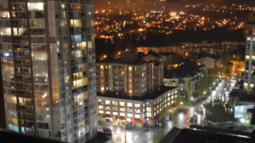 Time Lapse Of Apartment Building At Night Tilt Down Stock
