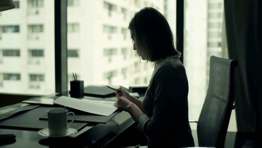 Young businesswoman with documents and tablet computer talking on phone in office  | Shutterstock HD Video #11826842