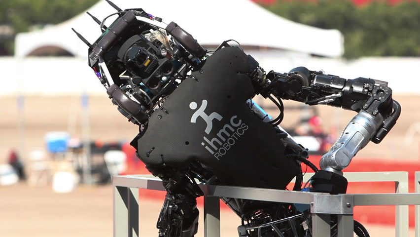 POMONA, CA - JUNE 6, 2015: IMHC Robotics Running Man Atlas robot collapses after finishing the DARPA Robotics Challenge then collapses in Pomona, CA on June 6, 2015. It finished all 50 minutes ranking 2nd.