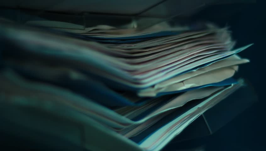 A pile of old papers in the office.