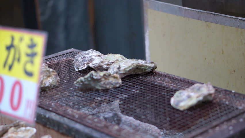 Video of chef opening of oysters at in fish market | Shutterstock HD Video #11869112