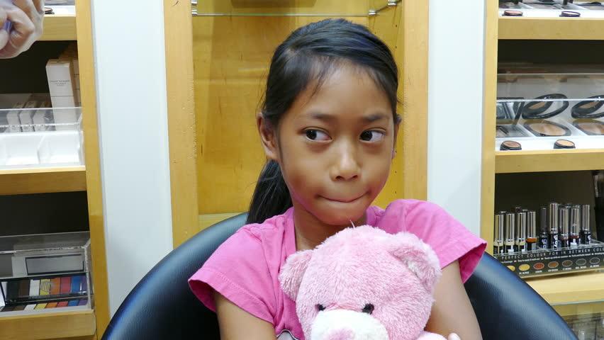 A Cute Little 9 Year Old Asian Girl Gets Her Ears Pierced -1407