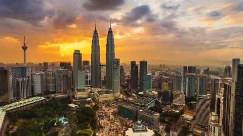 Time lapse: Beautiful and dramatic sunset view of the Kuala Lumpur skyline overlooking the national landmarks,  the Petronas Towers and Kuala Lumpur Tower.