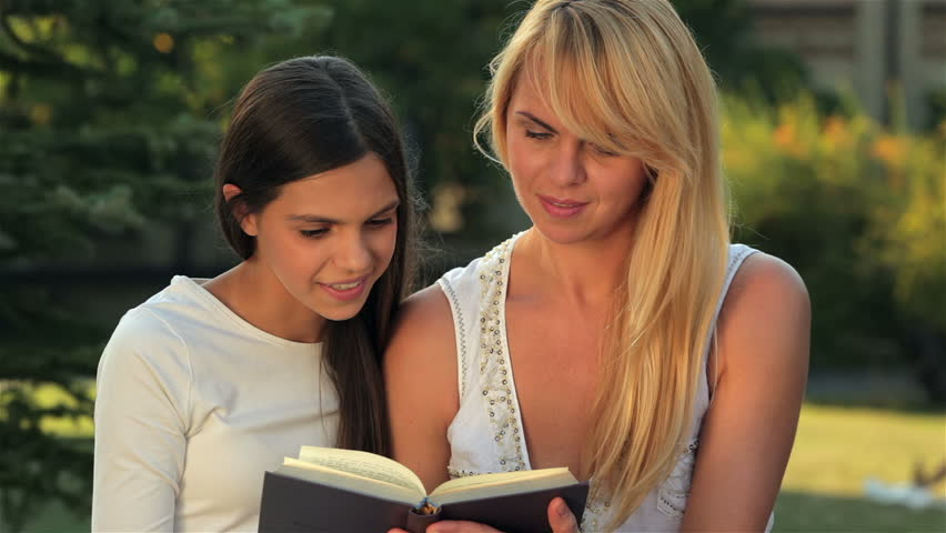 Mom And Daughter Reading A Book On A Bench Park Happy Mother With Her Daughter In Park Outdoors Teenage Girl Outdoor With Her Mom