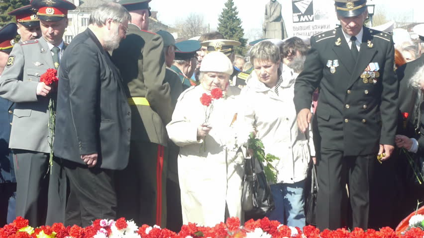 PETROZAVODSK, RUSSIA -MAY 09: Crowd of people lay flowers on the Victory Monument during Victory Day celebration in honor of the the 66th Anniversary of victory in World War II, May 09, 2011, Petrozavodsk, Russia.