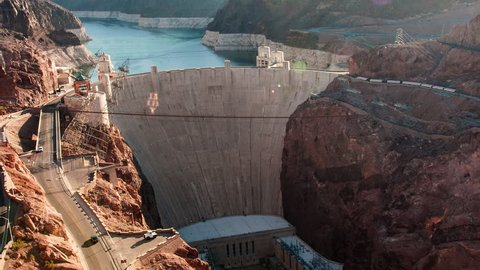 Time-lapse aerial shot of the Hoover Dam in Nevada with lens flare