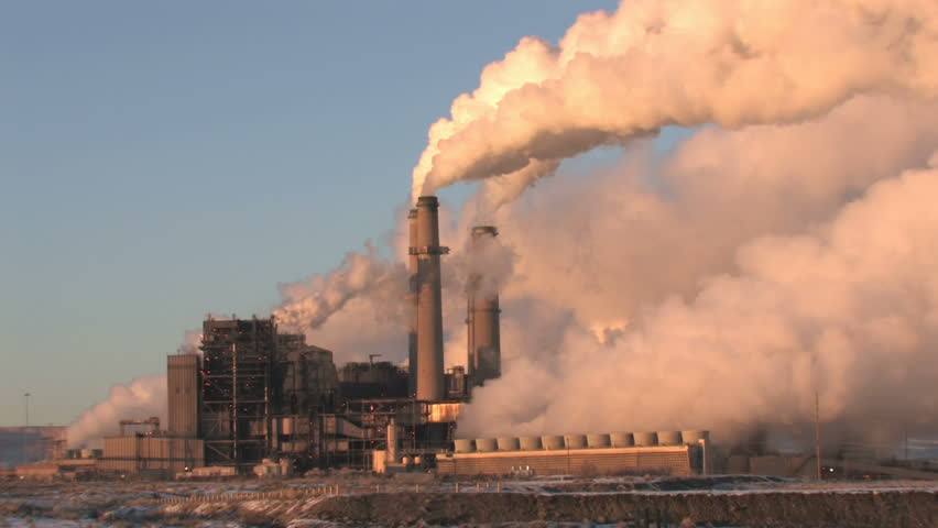 Video of pollution, smoke and steam discharged from a coal powered electrical generation facility in New Mexico. Contamination, pollution causing global warming and climate change. fast.