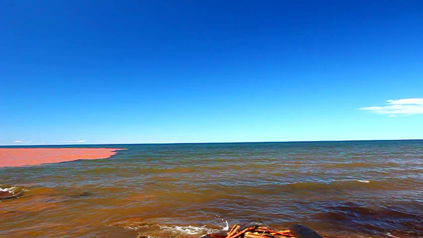 Big Iron River flows into the blue waters of Lake Superior after a heavy rainstorm in northwoods Michigan | Shutterstock HD Video #11970002