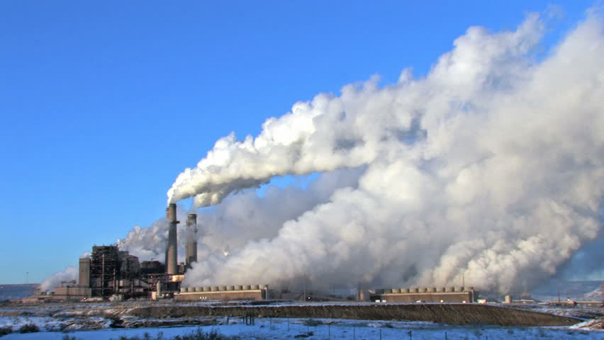 Pollution, smoke and steam discharged from a coal powered electrical generation facility in New Mexico. Pollution contamination, pollution and global warming and climate change.