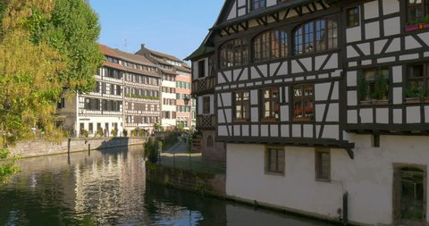 Pan tilt up right motion video of Petite France in Strasbourg city, french region of Alsace, Europe - an old town traditional medieval architecture of historic houses at river canal, european travel