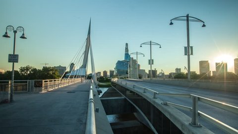 Winnipeg time lapse of gorgeous sunset over skyline while panning over Provencher Bridge.