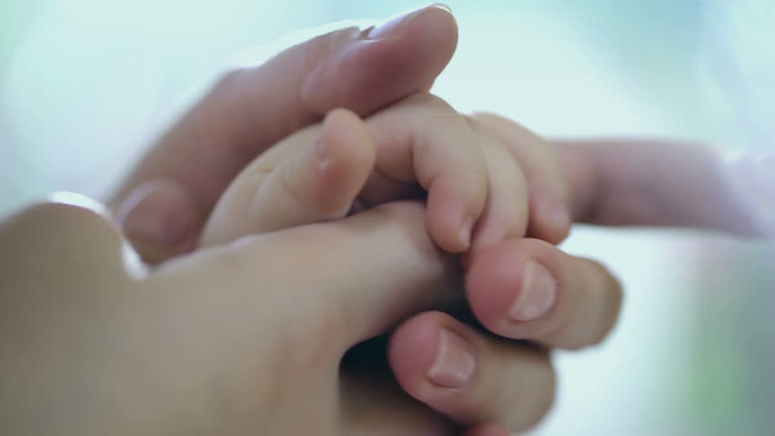Caring mother with baby, Concept of love and family. hands of mother and baby closeup, Hand in hand. Mother care. Playing with baby at home. Slow Motion.  FEW SHOTS ! | Shutterstock HD Video #12004886