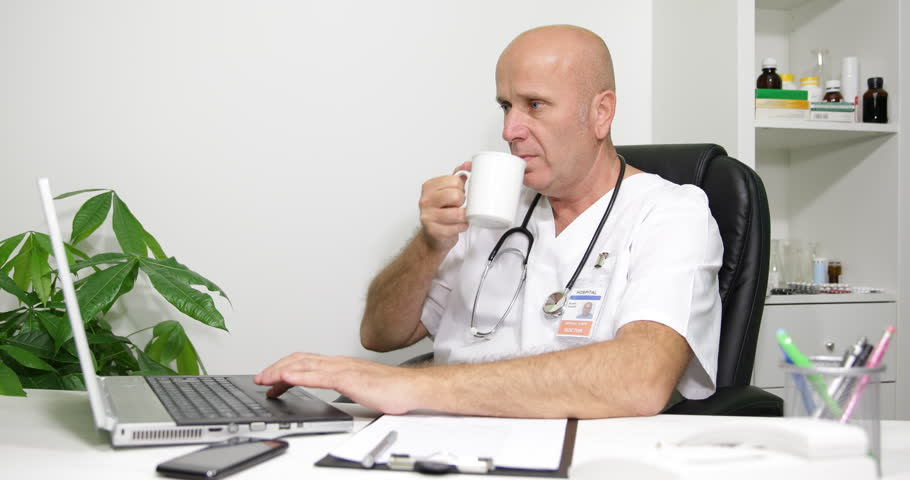 English Doctor Working Program Time Drinking Tea Access Laptop Internet Websites ( Ultra High Definition, UltraHD, Ultra HD, UHD, 4K, 2160P, 4096x2160 ) | Shutterstock HD Video #12009662