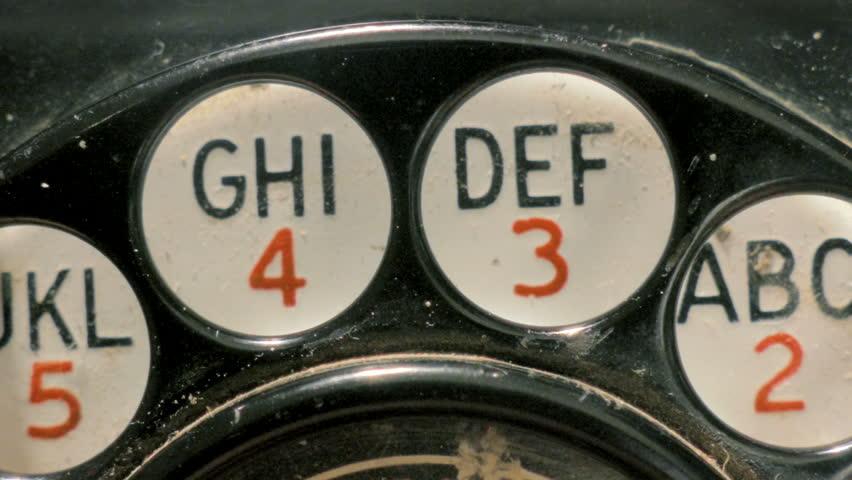 Dialing old retro rotary phone closeup