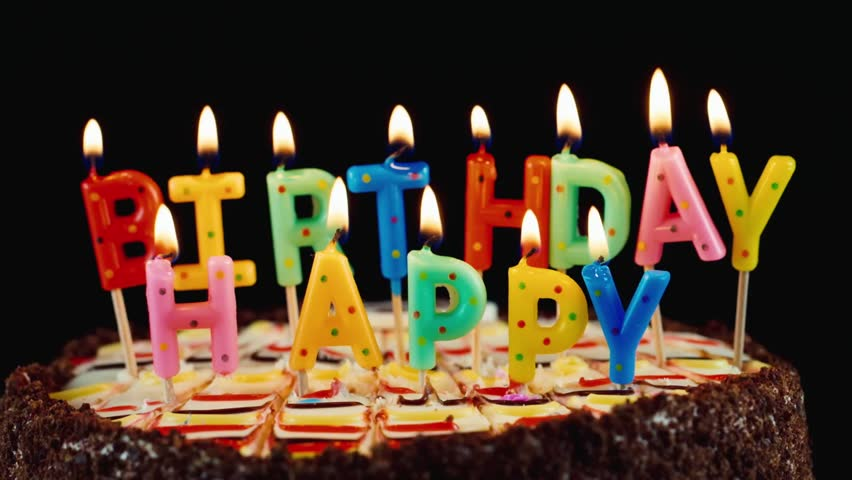 Stock Video Clip of Festive candles HAPPY BIRTHDAY on a cake