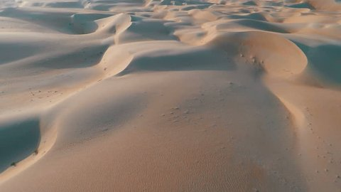 Endless rolling sand dunes aerial shot