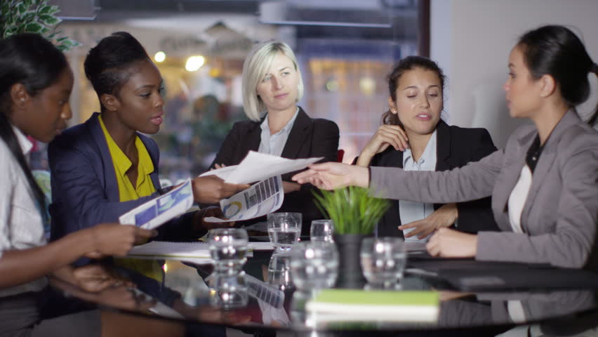 4k Female business group in a meeting - Lady boss watches over the rest of her team. Shot on RED Epic. | Shutterstock HD Video #12063131