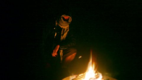 Terrorist near a bonfire