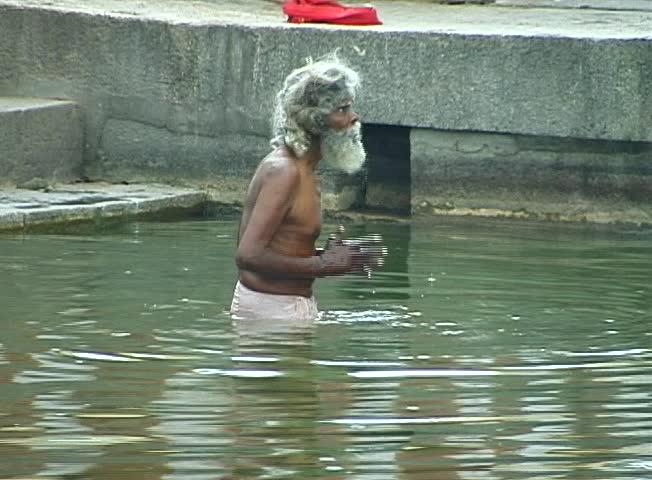 TAMIL NADU, INDIA – FEBRUARY 2000 –A Pilgrim bathing in a temple tank in South India.