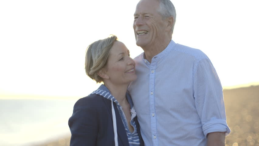 Portrait of Retired Senior Couple kissing on the beach
