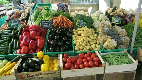 AIX-EN-PROVENCE, FRANCE - CIRCA 2015: Various vegetables and flowers freshly-picked on sale at farmer's market in the iconic Place Richelme, Aix-en-Provence, Provence, France