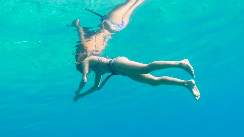 Beautiful female Free diver Swim at sea . #12207302