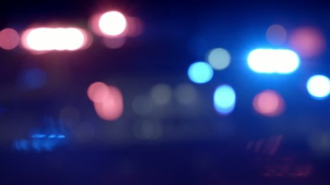 Ambulance, Cops and Firetrucks Blurry Lights Background at Night during a House Fire