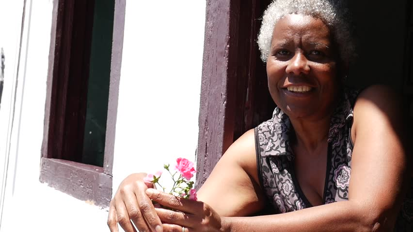 Brazilian Woman Smiles in a Window in a Typical House in Ouro Preto, Minas Gerais, Brazil
