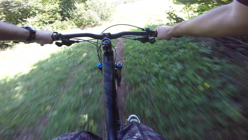 Mountain biking on a grassy green plateau | Shutterstock HD Video #12275642