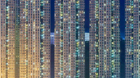 4k timelapse video of residential apartment buildings from day to night, camera zooming in