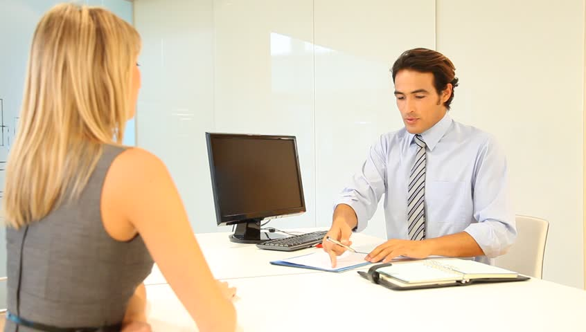 Car salesman with buyer in office