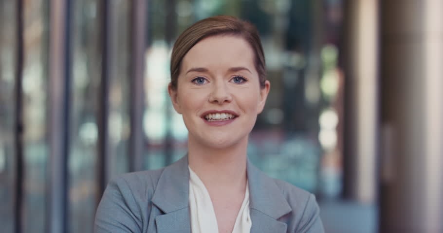 Portrait of Businesswoman smiling outside corporate office building real natural smile appearing confident | Shutterstock HD Video #12322172