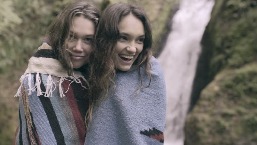 2 Friends Share A Blanket Together, They Laugh And Enjoy Nature Together (Slow Motion)