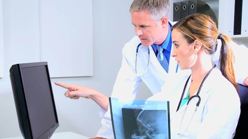 Close Up Male Consultant Female Doctor Examining Patient X-ray ...